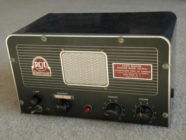 Shipboard receiver with 3 knobs and a center mounted speaker