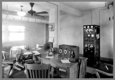 Another view of the later WUG2 radio room with transmitter in the background and operators desks (and receiver) in the foreground.