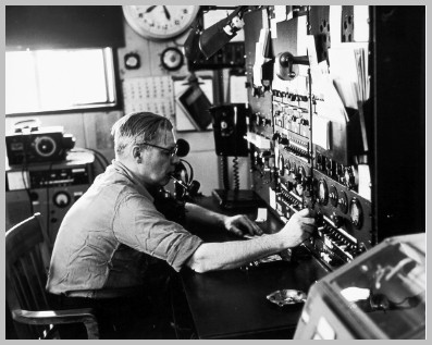 B & W photo of operator at the control board of radio station WAD in 1963