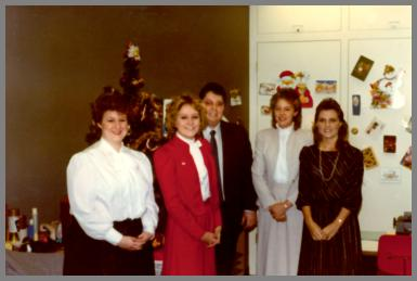 Five WCM Cincinnati employees at a Christmas party